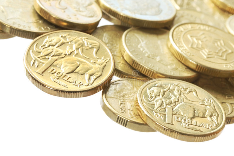 Australian Coins. Australian one dollar and two dollar gold coins, in macro royalty free stock photo