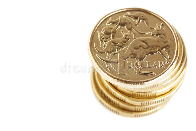 Australian currency. A stack of australian 1 dollar coins, isolated on a white background royalty free stock photo