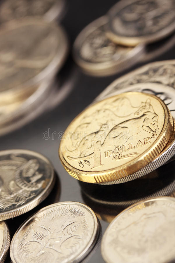 Australian currency. Various Australian coins, focus on gold 1 dollar coin royalty free stock images