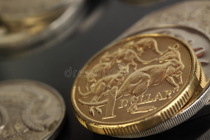 Australian currency. Various australian coins, focus on gold 1 dollar coin stock photo