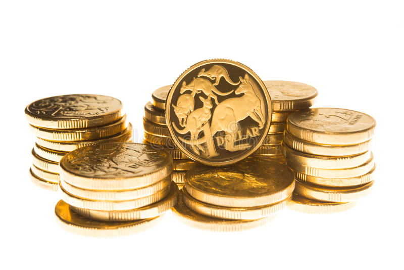 Australian currency. Australian one dollar coin stacked on a pile of coins stock photo