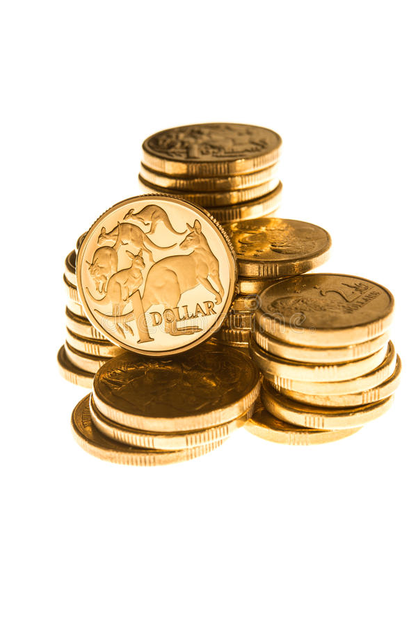 Australian currency. Australian one dollar coin stacked on a pile of coins stock images