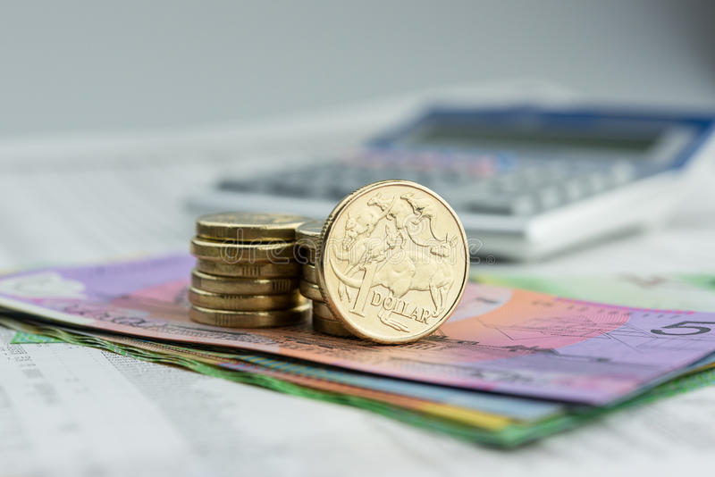 Australian currency. One and two dollar coins plus paper currency stock photos