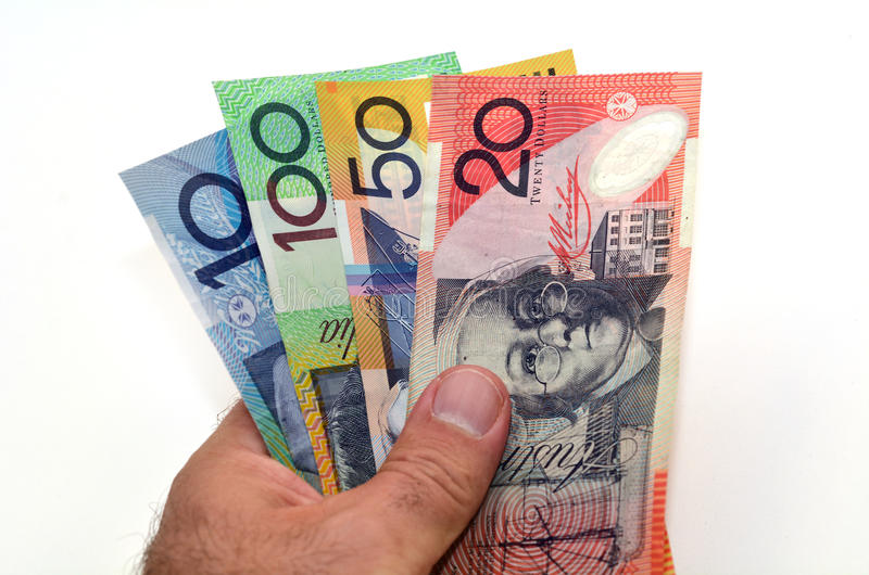 Australian Dollar banknotes. Mans hand holds Australian Dollar bank notes. Concept photo of money, banking ,currency and foreign exchange rates. (Isolated on royalty free stock photos