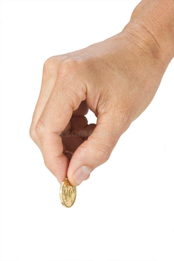 Australian Dollar Coin Hand Money. A mans hand holding an Australian one dollar coin stock image
