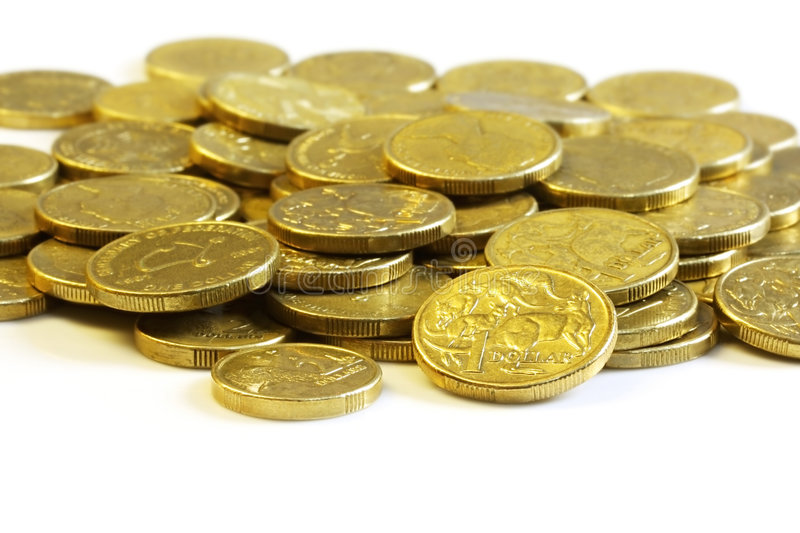 Australian Dollar Coins. Australian one dollar and two dollar coins, on white reflective surface stock image