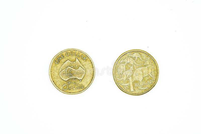 Australian dollar coins isolated on white background. One dollar. In both sides royalty free stock photography