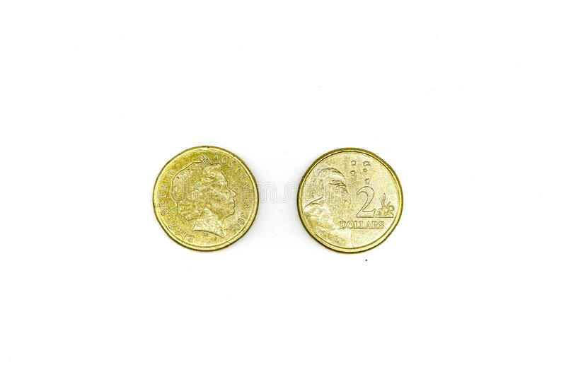 Australian dollar coins isolated on white background. Two dollars royalty free stock photography