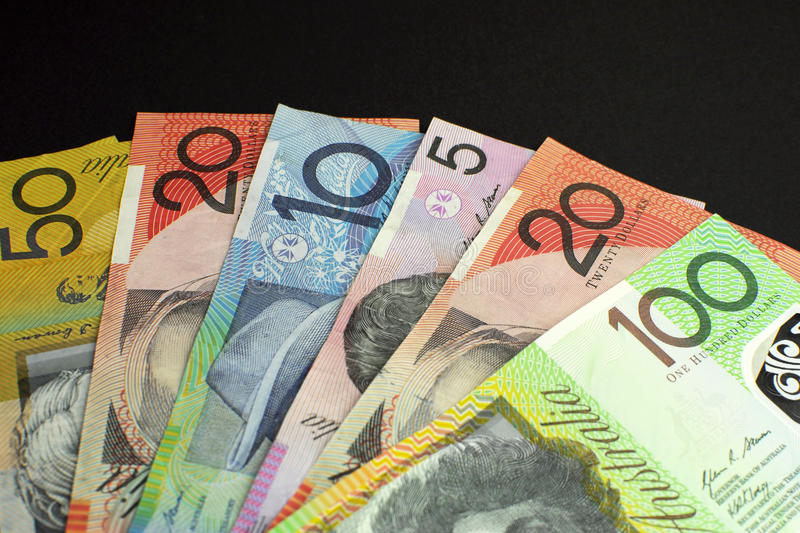 Australian dollar notes money - with copy space at top. Australian paper money, including one hundred, twenty, ten, five and fifty dollar notes against a black royalty free stock photography