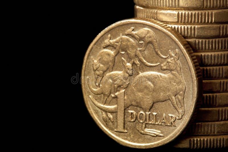 Australian Dollars. Australian dollar coins, over black background royalty free stock photography