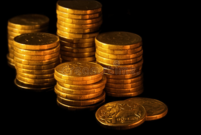 Australian Dollars. Stacks of Australian dollars in golden light, on black background royalty free stock images