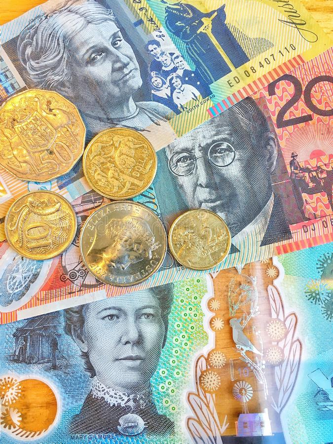 Australian Dollars AUD bank notes and coins background royalty free stock photos
