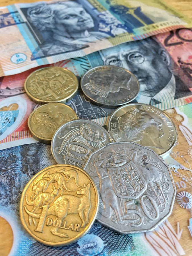 Australian Dollars AUD bank notes and coins background royalty free stock photography