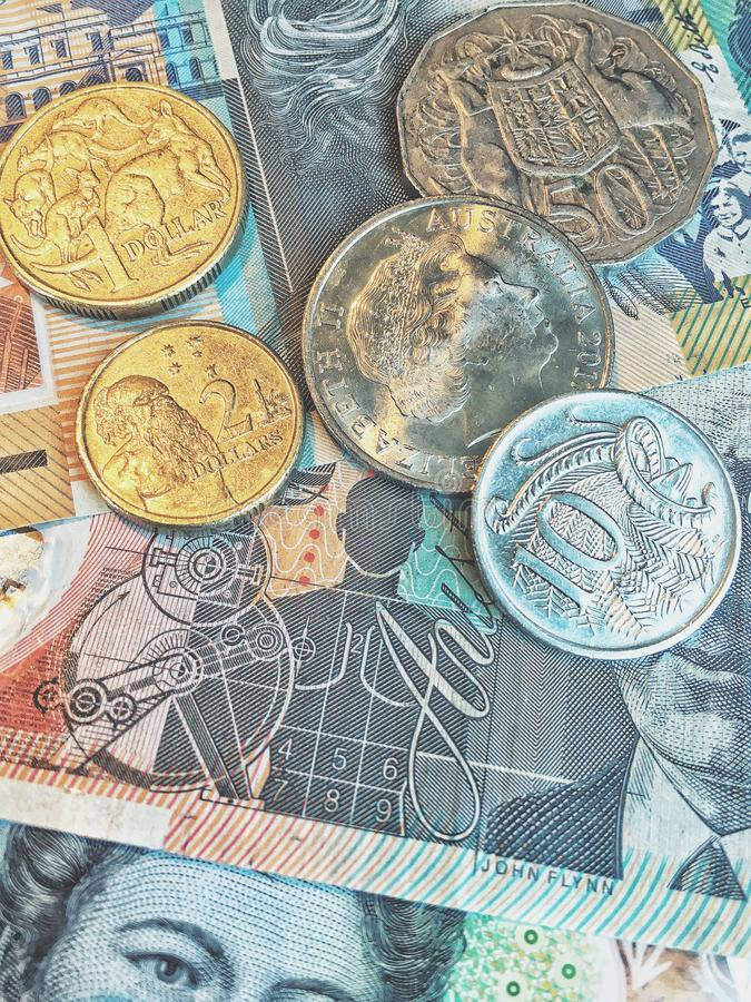 Australian Dollars AUD bank notes and coins background stock photography
