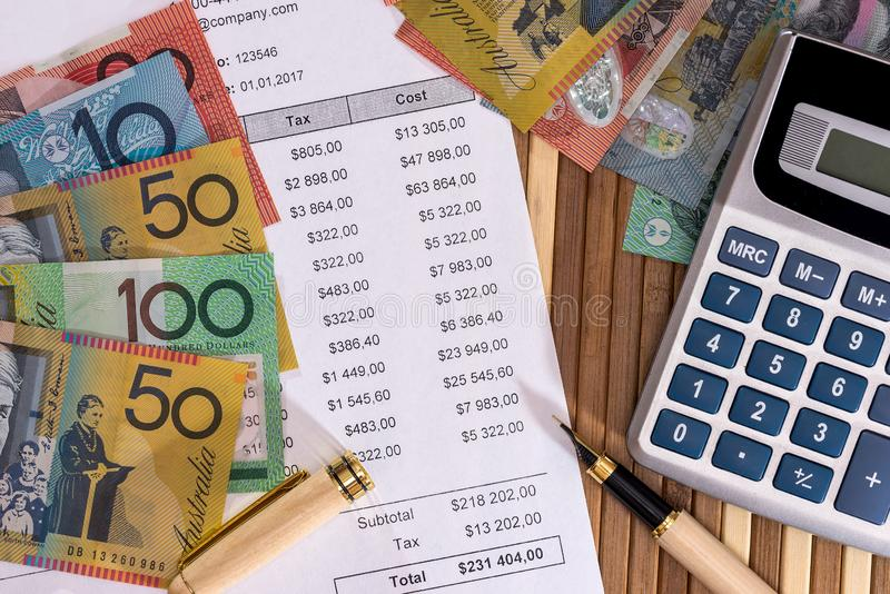 Australian dollars with purchase order and calculator.  stock photos