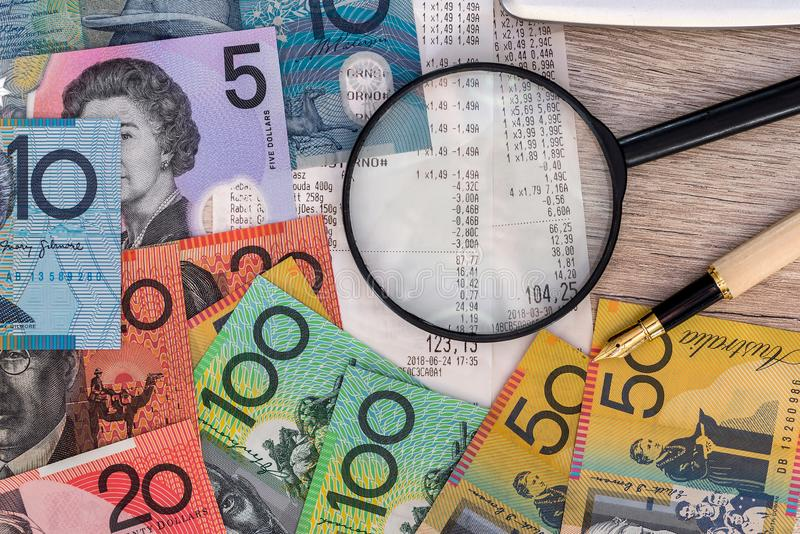 Australian dollars with receipt, calculator, pen and magnifier.  stock photo