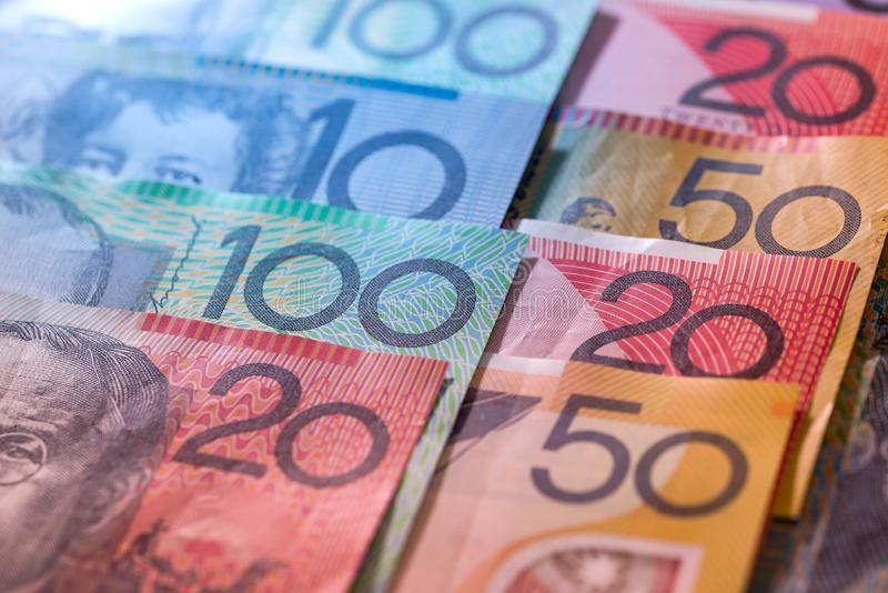 Australian dollars in rows as background. Banknotes of australian dollars in rows as background stock images