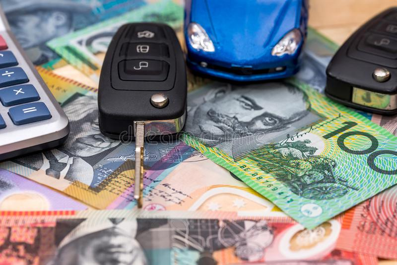 Australian dollars there are car, keys and calculator. On Australian dollars there are car, keys and calculator stock images