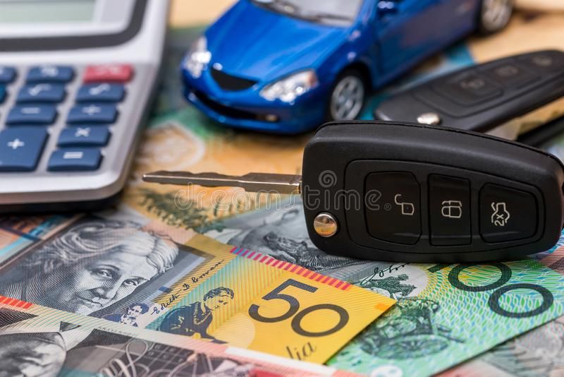 On Australian dollars there are car, keys and calculator.  royalty free stock image
