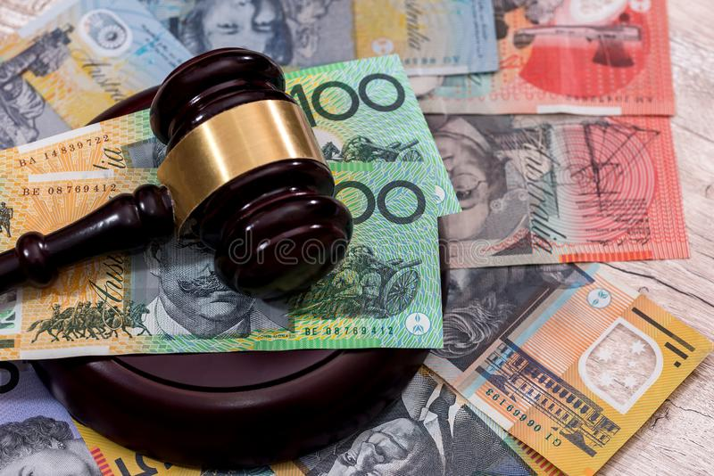 Australian dollars under judge`s gavel. Close up royalty free stock photos