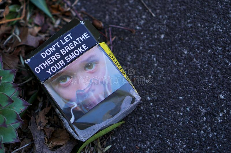 Australian empty abandoned cigarette pack on street royalty free stock images