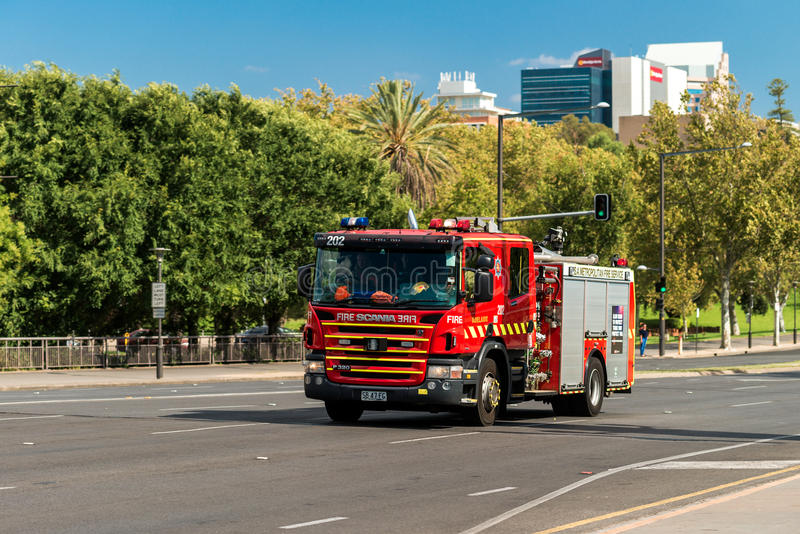 Australian Fire Truck. Adelaide, Australia - January 3, 2016: SA Metropolitan Fire Service Truck driving to an incident along King William road in Adelaide stock image