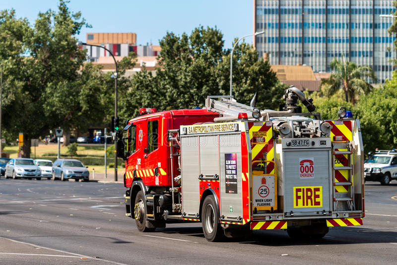 Australian Fire Truck. Adelaide, Australia - January 3, 2016: SA Metropolitan Fire Service Truck driving to an incident along King William road in Adelaide royalty free stock photography