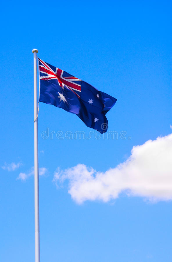 Australian Flag And Blue Sky Stock Image
