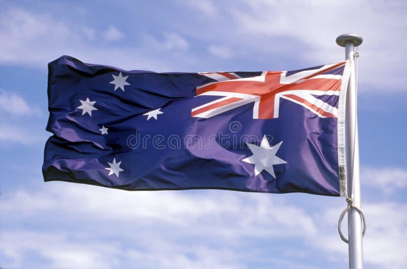 Australian flag flying. Australian flag flying from a flag pole royalty free stock photos