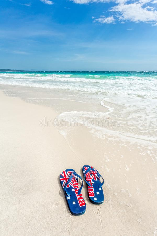 Aussie thongs on beach in summer royalty free stock photo