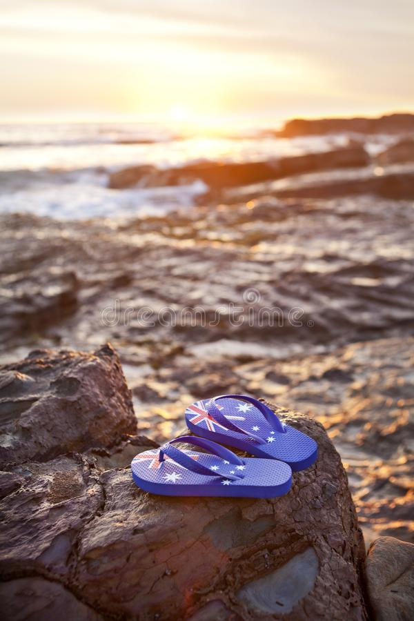 Australia Australian Flag Thongs Sunrise Beach Ocean Day royalty free stock photos