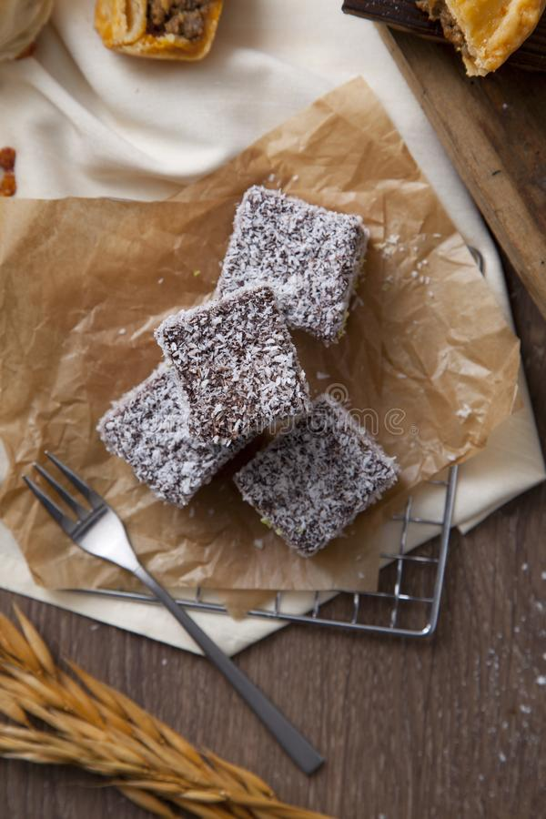 Australian Lamingtons cake with chocolate glaze and grated coconut royalty free stock image