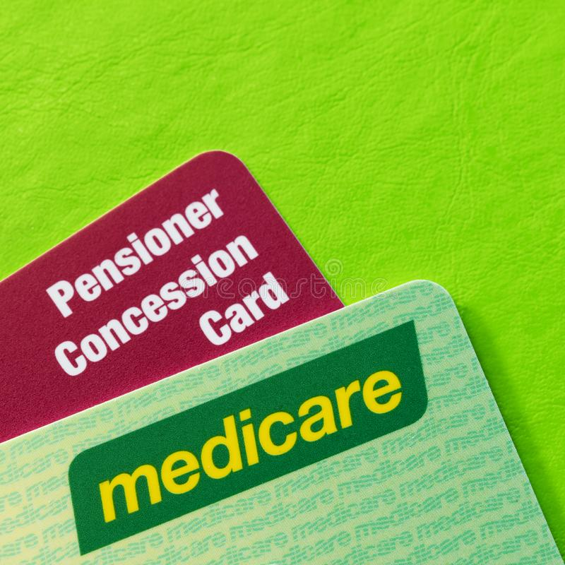 Australian Medicare and Pensioner Concession Cards over Vibrant Green Background. With copy space stock photo