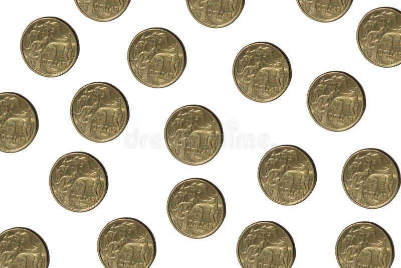 Australian money. Australian one dollar coins isolated on white royalty free stock photography