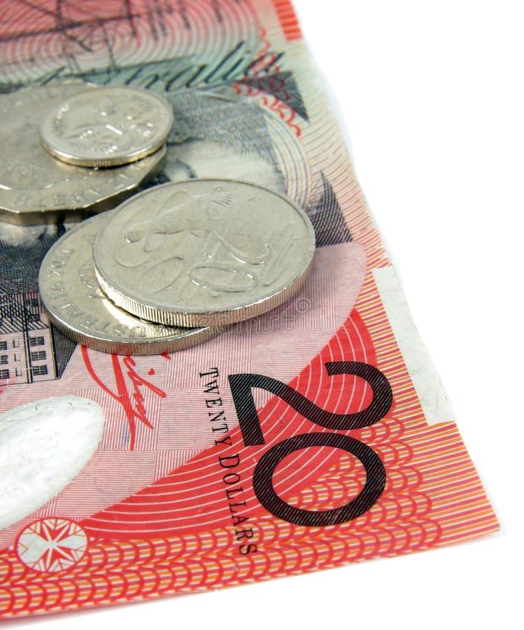 Australian money. Australian twenty dollars note and coins on white royalty free stock images