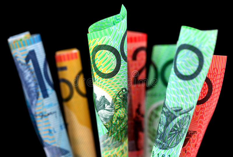 Australian Money. ~ furled Australian notes, with black background. Focus on front $100 note stock photo