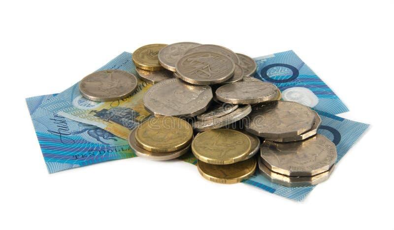 Australian money. Australian cash and coins over white stock photos