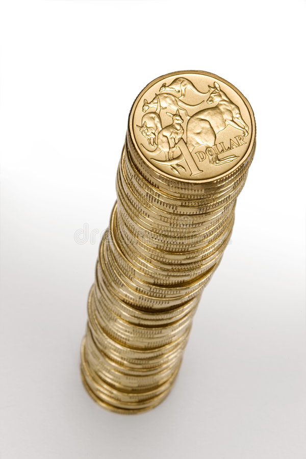Australian Money Dollar Coin Stack. A stack of Australian one dollar coins royalty free stock photography
