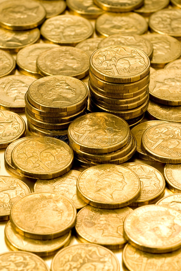 Australian Money Dollars Coins. Pile of Australian one dollar coins royalty free stock images