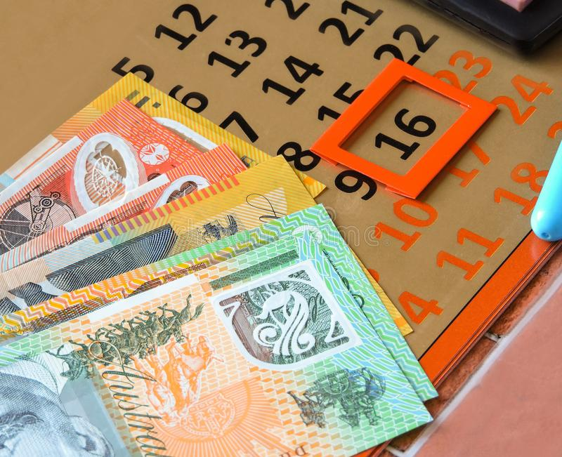 Australian money dollars, with notebook and calculator on the table.Financial and investment concepts. Financial and investment concepts.Australian Dollar bills royalty free stock images
