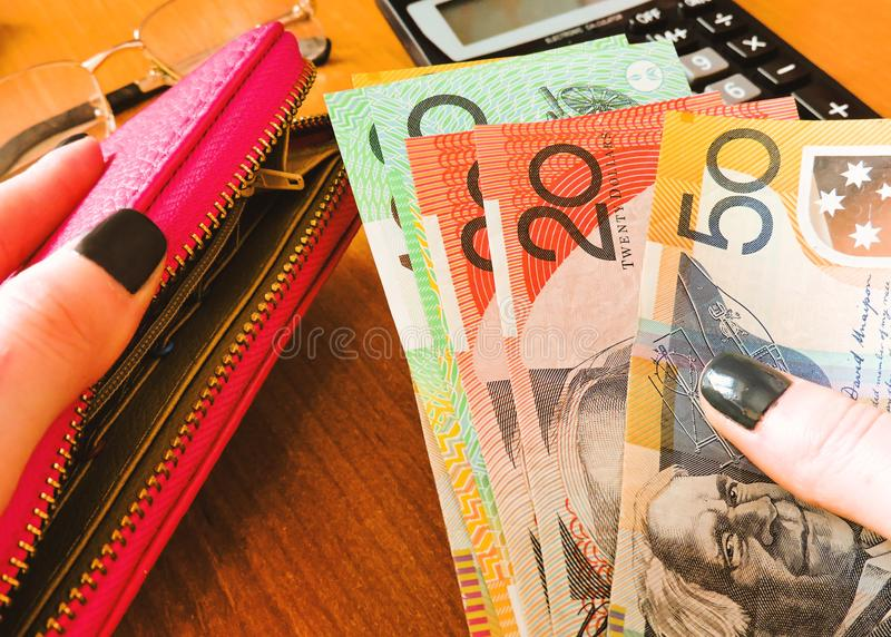 Australian money dollars, with notebook and calculator on the table.Financial and investment concepts. Financial and investment concepts.Australian Dollar bills stock images