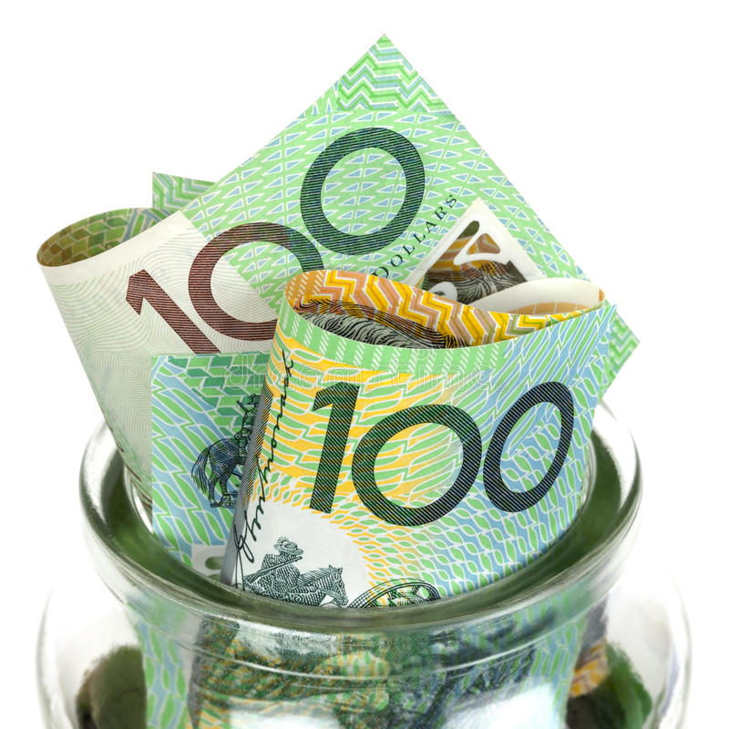 Australian Money in Jar. Over white background. One hundred dollar bills royalty free stock images