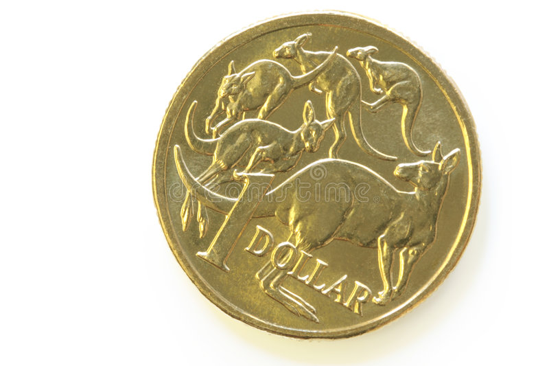Australian One Dollar Coin. With kangaroos, in close-up with soft shadow stock photography