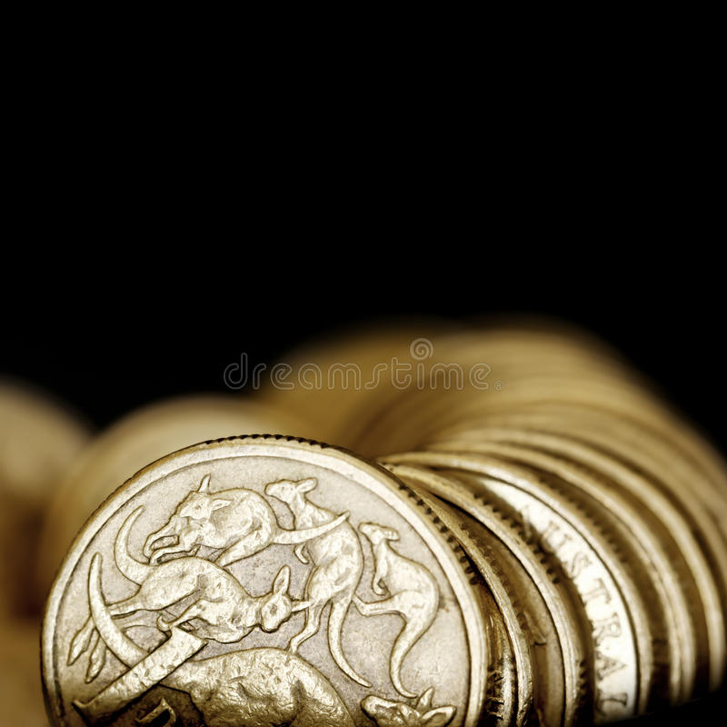 Australian One Dollar Coins over Black. Background royalty free stock image