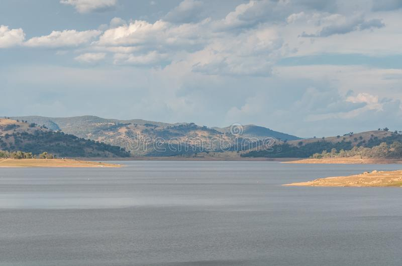 Australian outback landscape with lake and distant hills. Wyangala, Australia royalty free stock photography