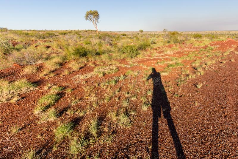 Australian outback landscape with the photographer`s shadow in the foreground royalty free stock photo