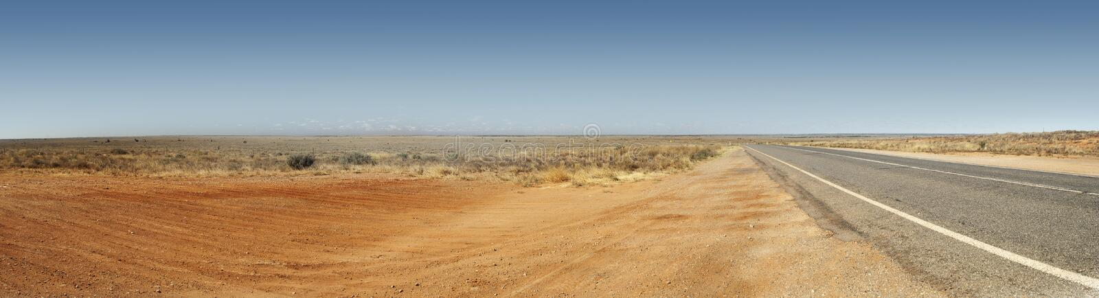 Australian Outback Road Panorama. Panorama of the Australian Outback with red dirt and remote road royalty free stock photography