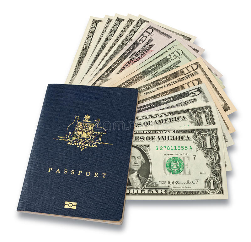 Australian Passport American Money. An Australian passport with American money fanning out on a white background. When the Australian dollar is strong, many royalty free stock photos