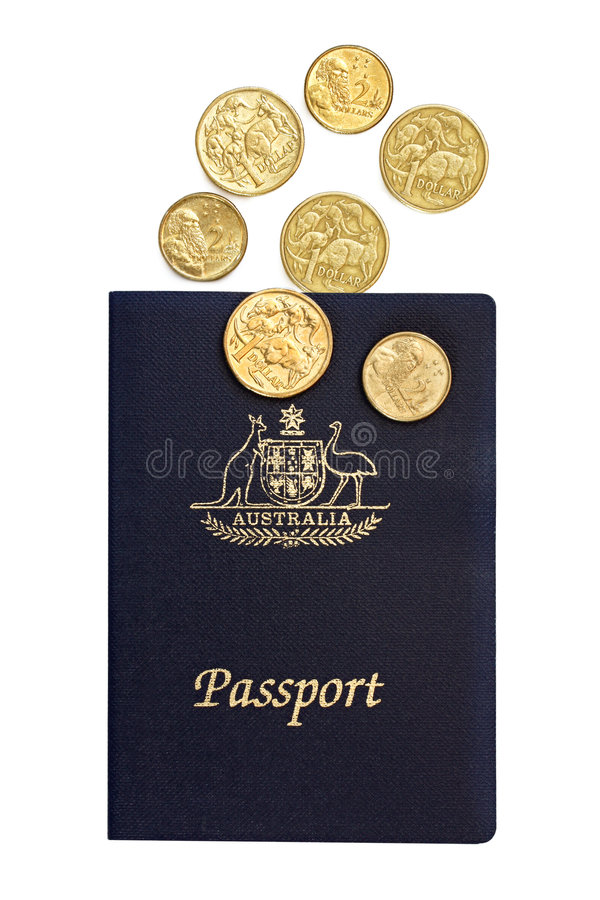 Australian Passport and Coins. Australian passport with one and two dollar coins. Isolated on white royalty free stock images