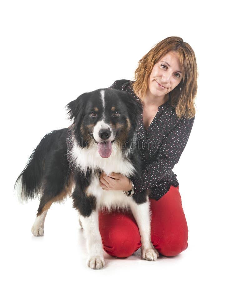 Australian shepherd and woman royalty free stock photo
